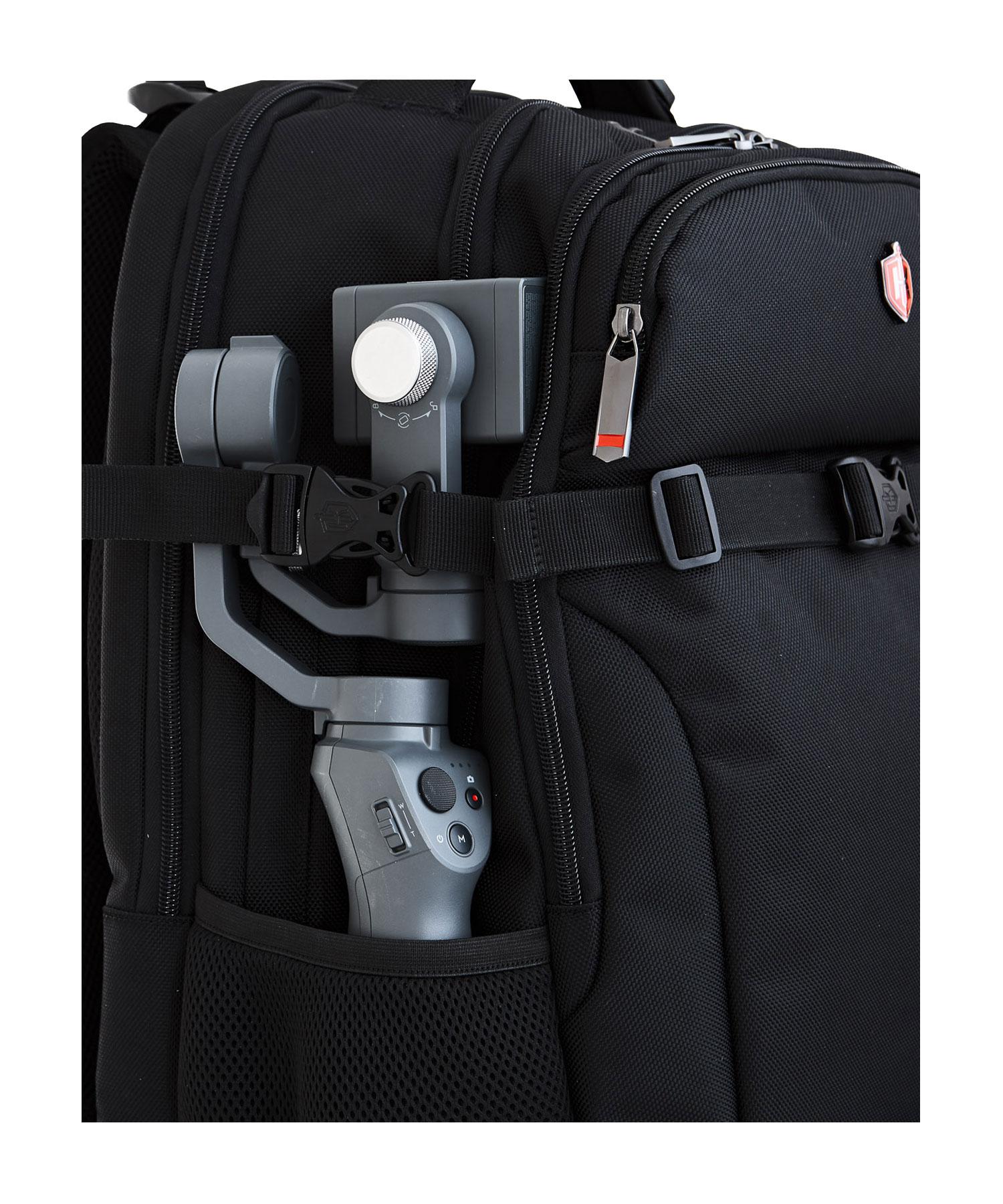 camera holder in a backpack pocket